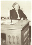 Dean Clauve Seated at Her Desk