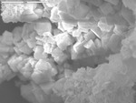 Cuboid crystals in iron oxide debris by M. Spilde