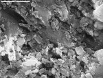 Detail of Mg coating from TP1-06 by M. Spilde, L. Melim, and D. Northup
