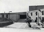 Wide-view of southern exterior main entrance (not Clinic entrance). by University of New Mexico School of Law