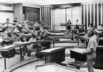 View of students and male professor in classroom 2402 during a lecture.