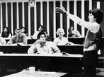 View of students and female professor in classroom 2406 during a lecture. by University of New Mexico School of Law
