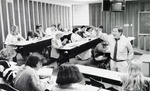 View of students and male professor in classroom 2405 during a lecture.