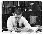 Caption: School of Law Library, scene of intensive study. by University of New Mexico School of Law
