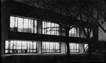 Exterior shot of law library's northwest windows at night.