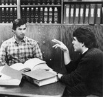 Two male sutdents in a study session at law library.