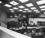 Bird's-eye view of circulation desk including entrance doors.