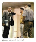 Caption: Discussion lasts past the class period. by University of New Mexico School of Law
