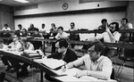 View of students in classroom 0000 during a lecture. by University of New Mexico School of Law