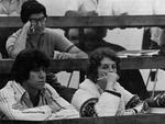 Close-up of three students during a lecture. by University of New Mexico School of Law
