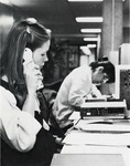 Female student using voice recorder. by University of New Mexico School of Law