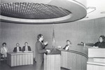 Male student arguing in Moot Court. by University of New Mexico School of Law