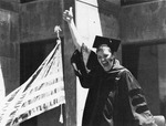 Student excited about graduating. by University of New Mexico School of Law