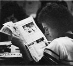 Student reading newspaper.