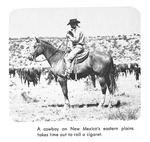 Caption: A cowboy on New Mexico's eastern plains takes time out to roll a cigaret.