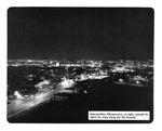 Caption: Metropolitan Albuquerque, at night, spreads its lights for miles along the Rio Grande.